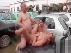 Threesome In A Junkyard With Two Chubby Chicks